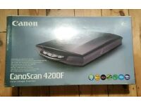 For sale is a Canon CanoScan 4200F scanner.