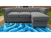 A New Hampton 3 Seater Slate Grey Fabric Material Buttoned Back Lounger.