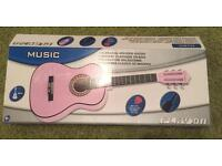 Pink guitar for ages 6-8 years