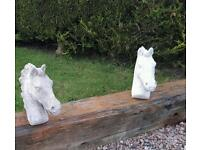 Pair of concrete horse heads for pillars