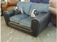 Ex display 2 seater sofa in black at only £145