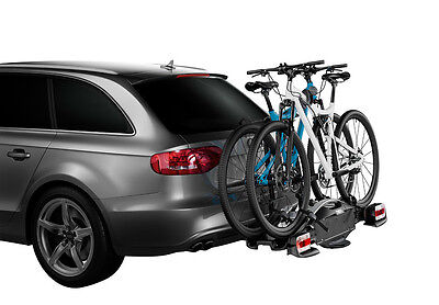 A Thule tow bar mounted cycle carrier loaded with 2 bikes.