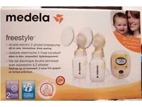 Medela Freestyle double electric breast pump with Calma Only £200 Bargain with lots of extras
