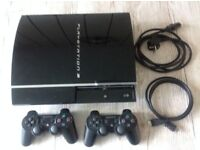 PS3 with 2 grip controllers and lots of games hardly used