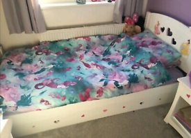Wooden single bed, can put a single mattress on the bottom draw.