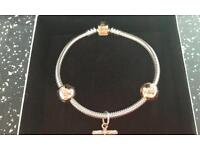 Brand new Pandora rose gold bracelet with charms