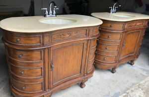 Elegant bathroom vanities (x2) with marble top and faucets