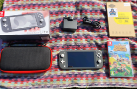 Nintendo Switch Lite + Animal Crossing & Extras