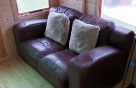 X 2 Brown Leather Sofa
