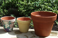 3 clay pots - largest never used - in excellent condition.