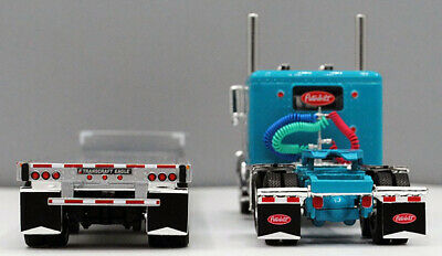 DCP 1/64 SCALE 389 PETERBILT FLAT, TURQUOISE WITH TRANSCRAFT STEPDECK TRAILER  1