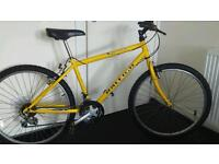 Yellow mountain bike.