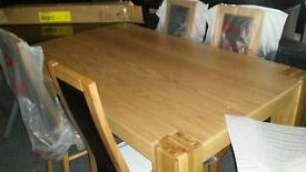 A brand new 150cms dinning table with four 2 tone dinning chairs.