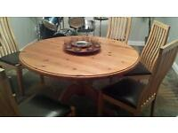 Round antique pine dining table