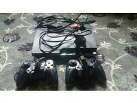 PS3 WITH 2 CONTROLLERS AND 7 GAMES