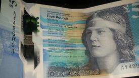 New plastic five pound note