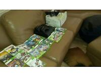 Xbox 360 plus loads of games and accessories.