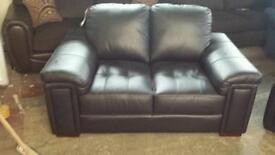 Black leather 2 seater sofa good savings only £155