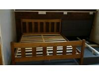 A brand new solid pine king size bed frame.