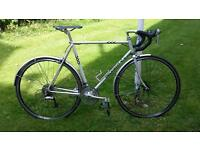Road bike with mudguards.