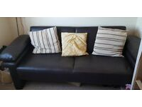 Dark Brown Leather Sofa Bed with Pillows