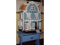 1/2th scale dolls house sits on its own unit all lights up