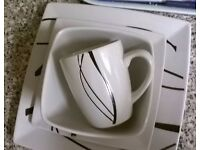 16 Piece White/Black Dinner Set with Delicate Ribbon Pattern