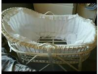 Wicker moses basket and sand