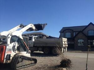 tandem axle dump truck for hire and skid steer bobcat