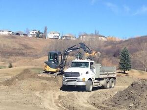 tandem axle dump truck for hire and or skid steer bobcat