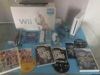 Wii blanche complete -manette- nunchock- jeux -100$