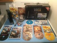 Wii noire complete - manette-nunchock- jeux - 90$