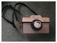 Ladies monsoon/assescories camera shaped bag