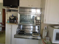 Counter top vintage Moffat stove and oven with hood.