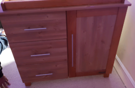 Cot bed and changing unit with drawers