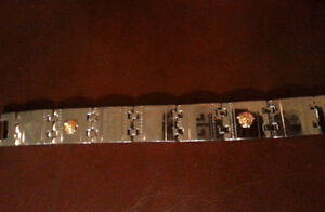Bracelet Versace avec têtes en or 18k
