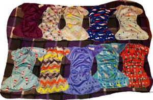 10 gently used  lil helper cloth diapers.