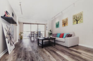 Bright and spacious 1 bd + den - utilities/parking/internet incl