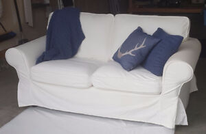 White Loveseat w/ Navy Blue Decorative Toss Pillows & Throw