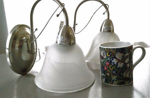 Two silver, frosted-glass wall sconces