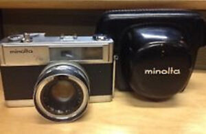 Vintage Minolta 35mm camera, Lens, Flash