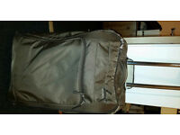 Brown large suitcase with rigid back