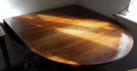 Mahogany and ebony strung dining table