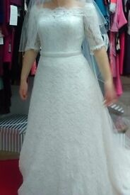 Elegant Ivory Wedding Dress new and unworn with tags size 12
