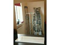 Bathroom glass mirror with shelf.