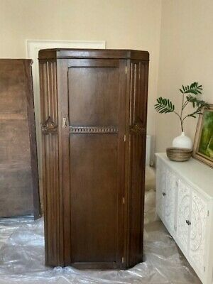 Antique wardrobe gentleman's armoire hall or bedroom cupboard in oak.