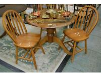 Pine table and 3 wheel back chairs