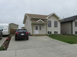 Two bedroom Home, SK side - large fenced yard - South Side
