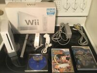 Wii complete -manette-nunchock-2 jeux-90$