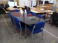 Large boardroom table with 8 blue stackable chairs